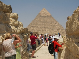 Tourists near a pyramid in Egypt