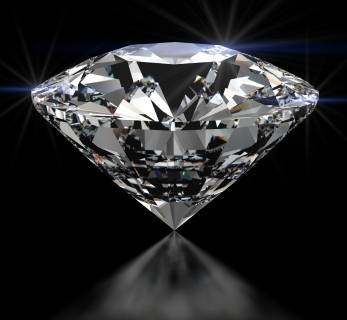 A sparkling diamond on a reflective surface
